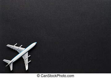Airplane on a black background with copy space