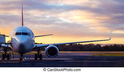 Airplane on Airport Runway at Sunset in Tasmania