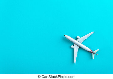 Airplane on blue pastel color background.