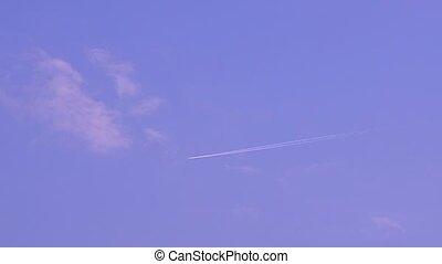 Airplane on blue sky draws strip