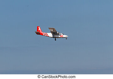 Airplane on Helgoland heading to land on the dune