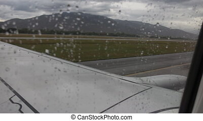 Airplane on runway in rainy day, stock video