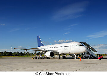 Airplane on tarmac - Commercial airliner parked in a...