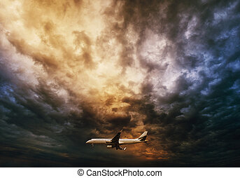Airplane over dramatic sky