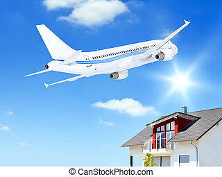 airplane over house - An image of an airplane over a private...