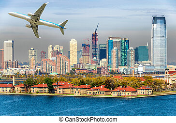 Airplane over Jersey City, NJ. Travel concept.
