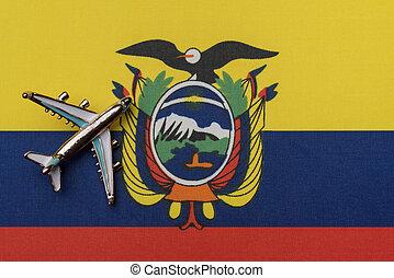 Airplane over the flag of Ecuador travel concept.