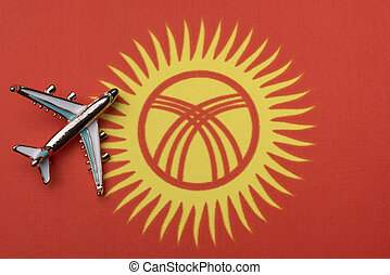 Airplane over the flag of Kyrgyzstan, the concept of travel.