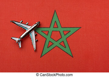 Airplane over the flag of Morocco, the concept of travel.