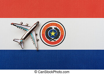 Airplane over the flag of Paraguay travel concept in the country.