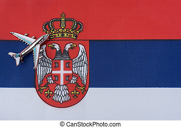 Airplane over the flag of Serbia travel concept.
