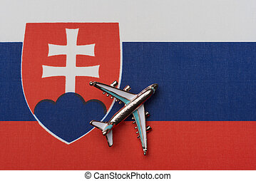 Airplane over the flag of Slovakia, the concept of travel.