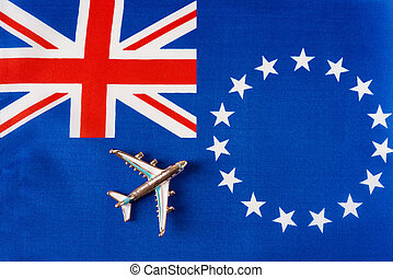 Airplane over the flag of the cook Islands travel concept.