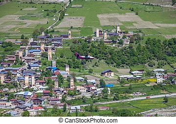 Airplane over the village of Mestia, Svaneti, Georgia.