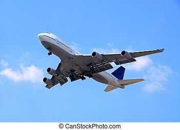 Passenger airplane flying in bright blue sky