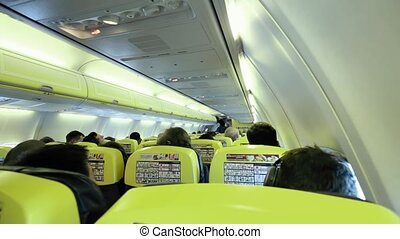 Airplane Passenger Cabin With People.
