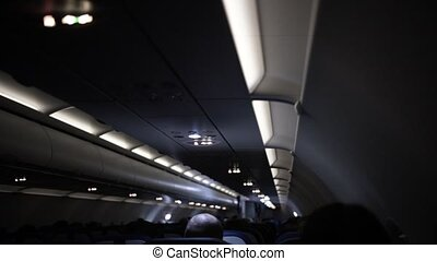 Airplane. Passengers cabin of airplane in night time.