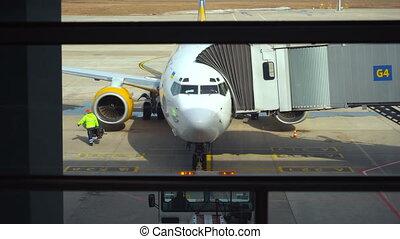 Airplane preparation before flight in airport