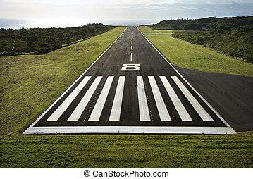 Airplane runway. - Aerial view of paved airplane runway on...