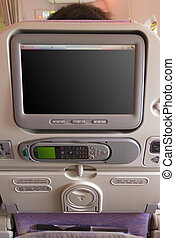 Airplane seat back screen - Airplane seat back on an Airbus...