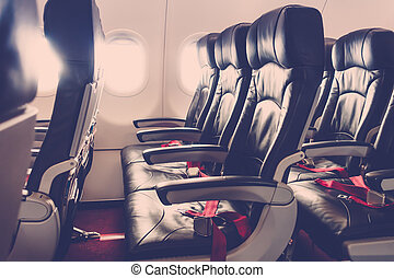 Airplane seats in the cabin .( Filtered image processed vintage effect. )