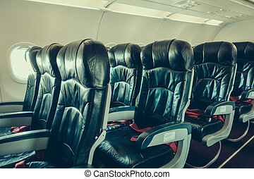 Airplane seats in the cabin . ( Filtered image processed vintage effect. )