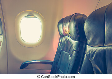Airplane seats in the cabin . ( Filtered image processed...