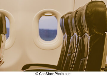 Airplane seats in the cabin ( Filtered image processed vintage effect. ) .