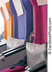 airplane seats without passengers with comfortable cushions