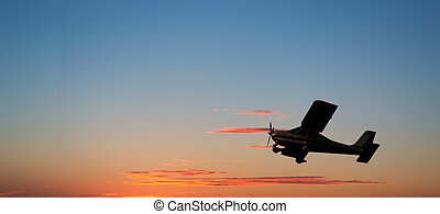airplane silhouette at sunset