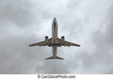 Airplane Silhouette, Overcast Sky