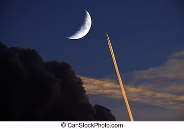 Airplane Soaring Through Sky Jet Trail and Crescent Moon sunset
