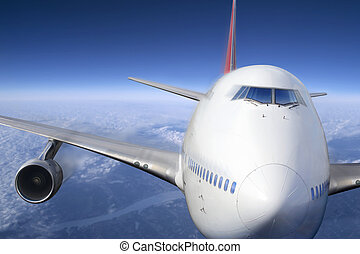 Airplane - A passenger jet flying high above the clouds.