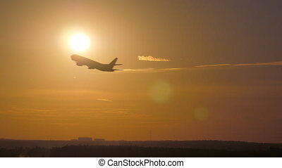 Airplane takeoff at sunset - Sunset and silhouette of...