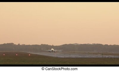Airplane takes off during sunset. - Commercial airplane...