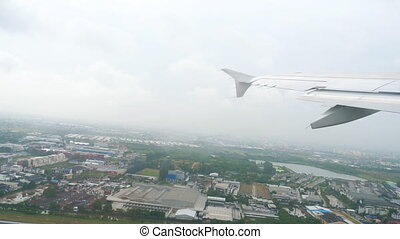 Airplane takes off during the rain from international...