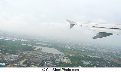 Airplane takes off during the rain from Suvarnabhumi...
