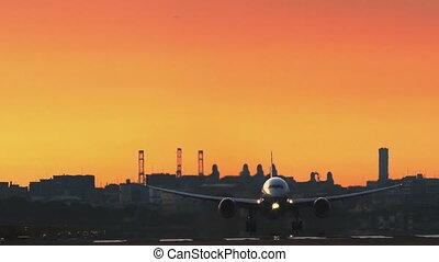 airplane taking off at sunset (Fukuoka Airport, Japan)