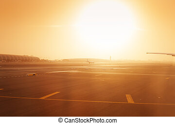 Airplane taxiing on at airport runway in haze