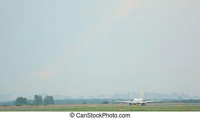 Airplane taxiing on runway