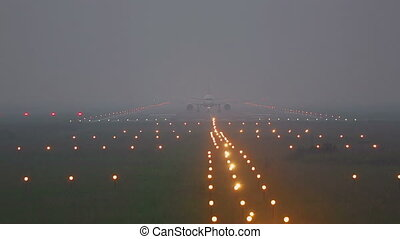 Airplane taxiing on runway in fog - Airplane taxiing on the...