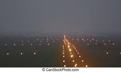 Airplane taxiing on runway in fog