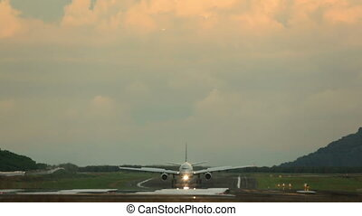 Airplane taxiing - The aircraft taxiing on runway after...
