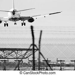 airplane telephoto - an airplane landing at barcelona...