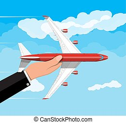 Passenger or commercial jet in hand