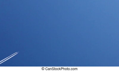 Airplane trails across clear blue sky - Airplane vapour...