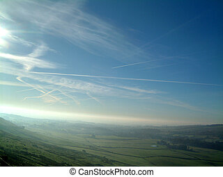 Airplane trails in the Blue sky above central Scotland