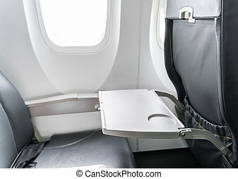 Airplane tray table on seat back . - Airplane tray table on...