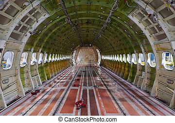 Airplane under maintenance - Cabin of the airplane under...