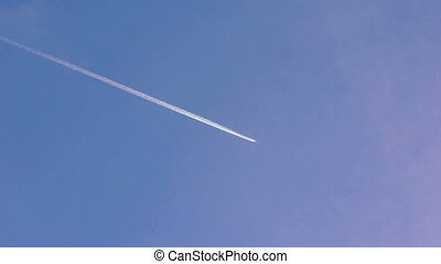 Airplane vapour trails across clear blue sky in full HD